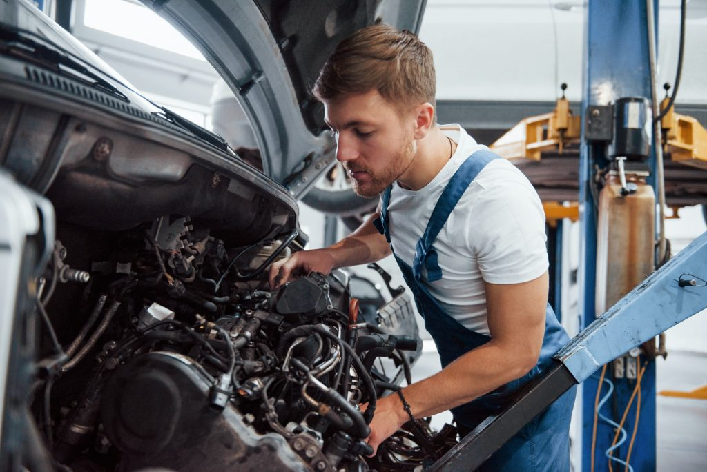Careful with that. Employee in the blue colored uniform works in the automobile salon
